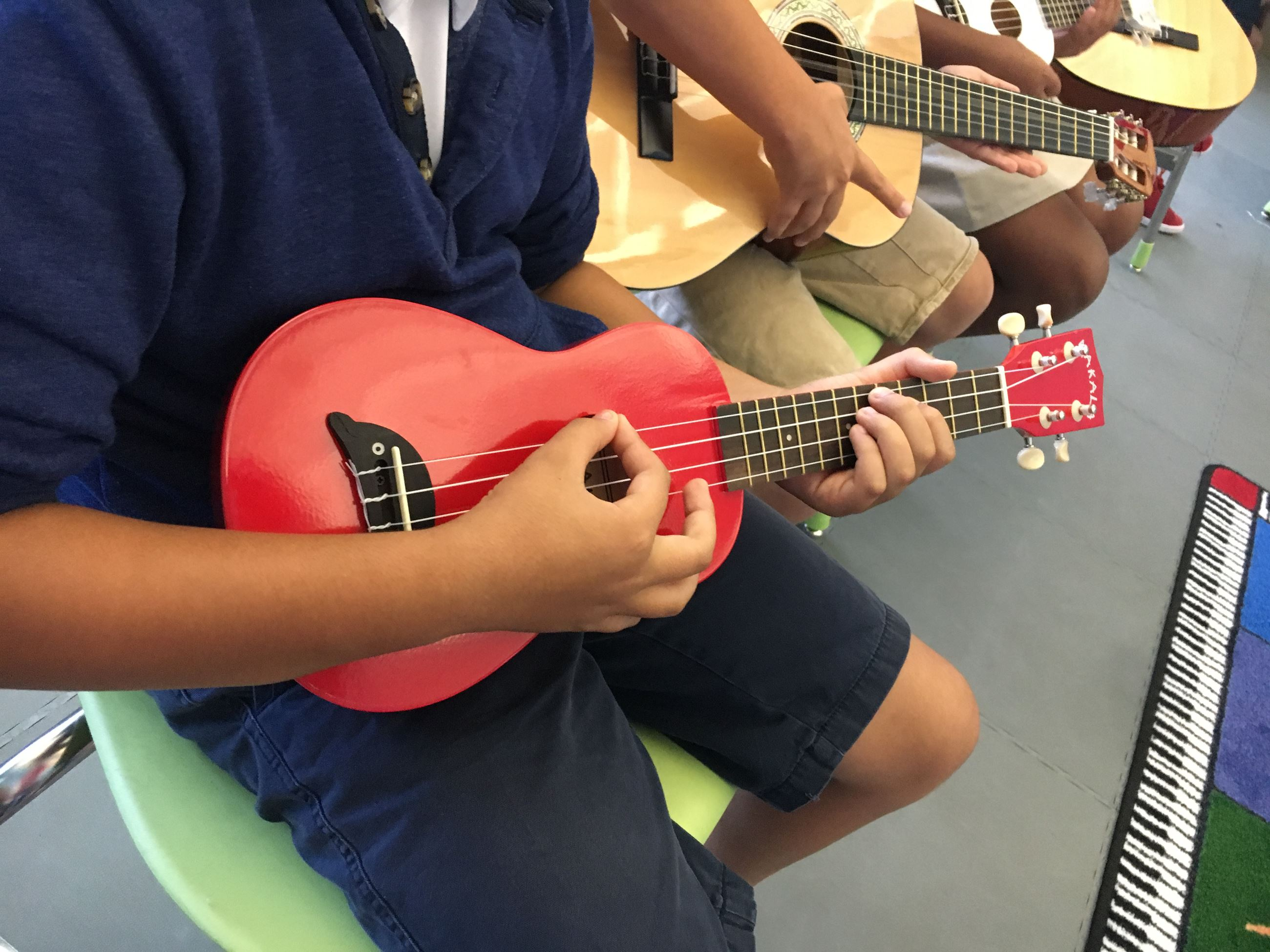 Students practicing with guitars.